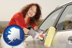 alaska a woman painting a car with a paint roller