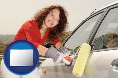 colorado a woman painting a car with a paint roller