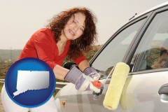 connecticut a woman painting a car with a paint roller