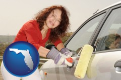 florida a woman painting a car with a paint roller