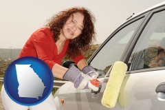 georgia a woman painting a car with a paint roller