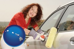hawaii a woman painting a car with a paint roller