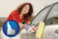 idaho a woman painting a car with a paint roller
