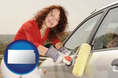 kansas a woman painting a car with a paint roller