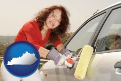 kentucky a woman painting a car with a paint roller