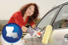 louisiana a woman painting a car with a paint roller