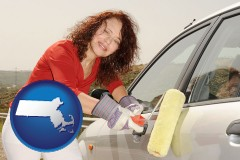 massachusetts a woman painting a car with a paint roller