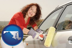 maryland a woman painting a car with a paint roller