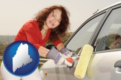 maine a woman painting a car with a paint roller
