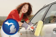 michigan a woman painting a car with a paint roller