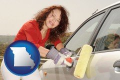 missouri a woman painting a car with a paint roller