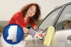 mississippi a woman painting a car with a paint roller