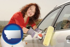 montana a woman painting a car with a paint roller