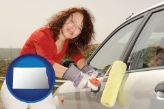 north-dakota a woman painting a car with a paint roller