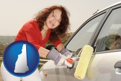 new-hampshire a woman painting a car with a paint roller
