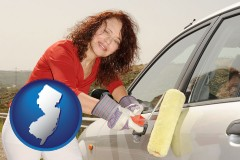 new-jersey a woman painting a car with a paint roller