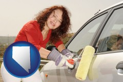 nevada a woman painting a car with a paint roller