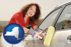 new-york a woman painting a car with a paint roller