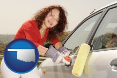 oklahoma a woman painting a car with a paint roller