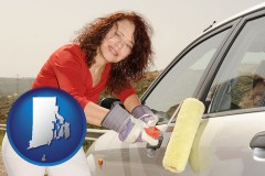 rhode-island a woman painting a car with a paint roller