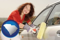 south-carolina a woman painting a car with a paint roller