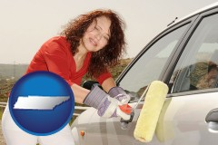 tennessee a woman painting a car with a paint roller