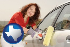 texas a woman painting a car with a paint roller