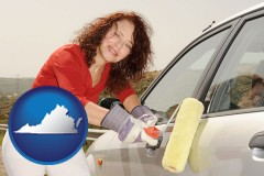 virginia a woman painting a car with a paint roller