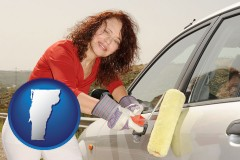 vermont a woman painting a car with a paint roller