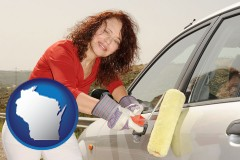 wisconsin a woman painting a car with a paint roller