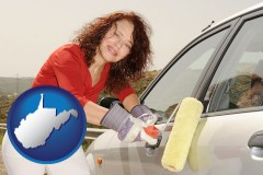 west-virginia a woman painting a car with a paint roller