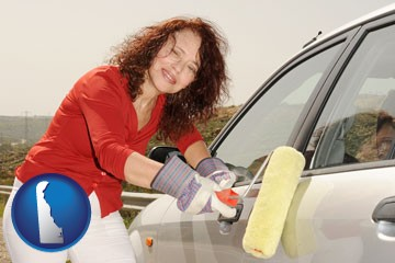 a woman painting a car with a paint roller - with Delaware icon