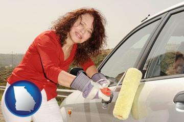 a woman painting a car with a paint roller - with Georgia icon