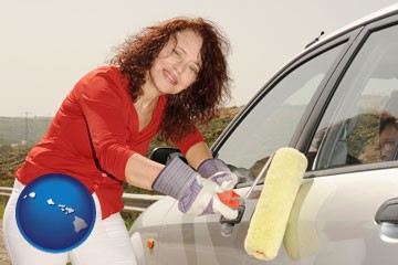 a woman painting a car with a paint roller - with Hawaii icon