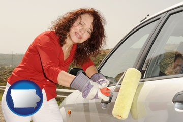 a woman painting a car with a paint roller - with Iowa icon
