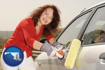 a woman painting a car with a paint roller - with Maryland icon