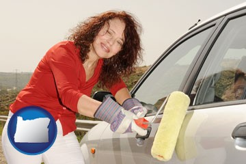 a woman painting a car with a paint roller - with Oregon icon