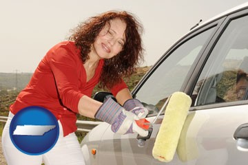 a woman painting a car with a paint roller - with Tennessee icon