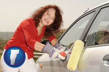 a woman painting a car with a paint roller - with Vermont icon